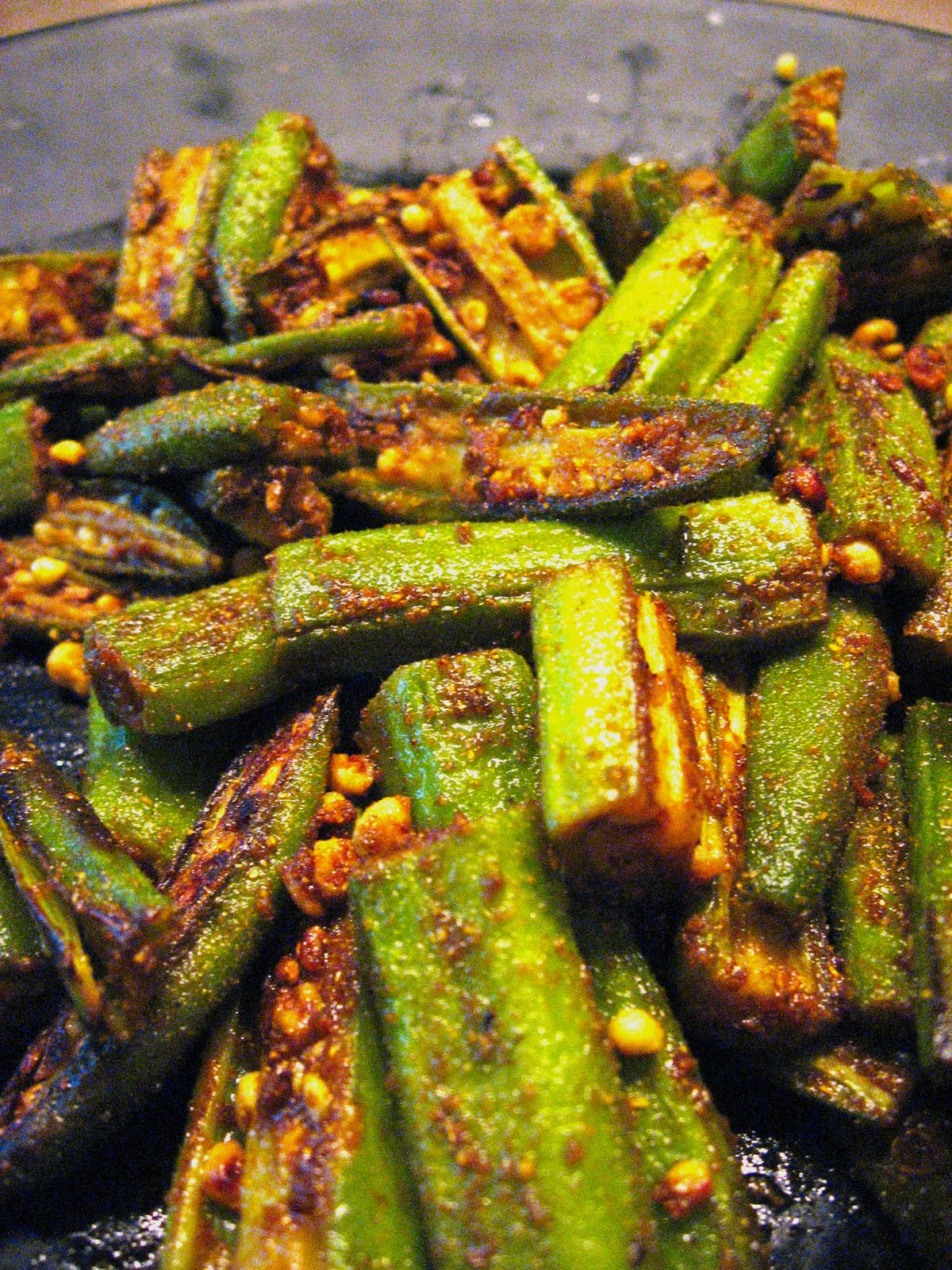 about 12 pound of okra wash let completely dry trim both ends cut hot dog style and cut into smaller pieces if okra are large - Manjulas Kitchen 2